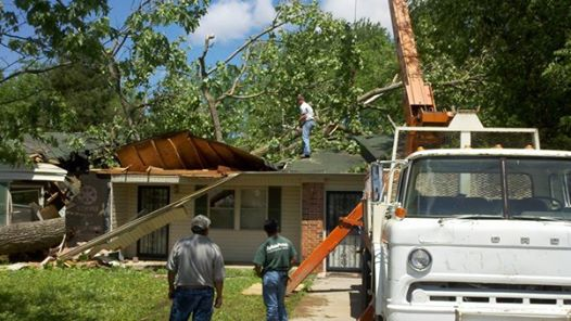 Arbor Pro Tree Service Company removing a tree that has fallen on a home in Montgomery, Alabama
